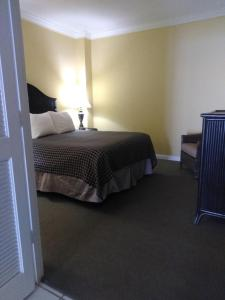 A bed or beds in a room at Coconut Malorie Resort Ocean City a Ramada by Wyndham