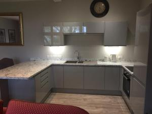 A kitchen or kitchenette at School House