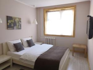 Кровать или кровати в номере Нефтехимик