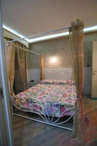 Кровать или кровати в номере Pensione Enea