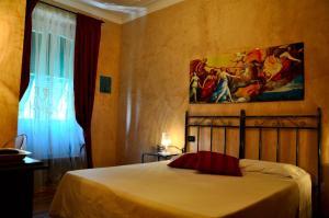 Ein Bett oder Betten in einem Zimmer der Unterkunft Locanda Villa Moderna