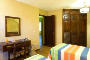 A television and/or entertainment center at Vista Vallarta All Suites On The Beach