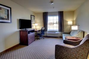 A television and/or entertainment center at Cobblestone Hotel & Suites - Newton