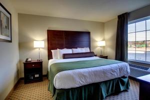 A bed or beds in a room at Cobblestone Hotel & Suites - Newton