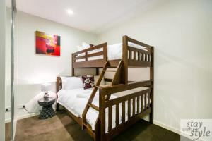 A bunk bed or bunk beds in a room at Melbourne Star - central city location - sleeps 5