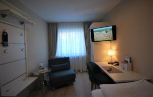Ein Sitzbereich in der Unterkunft Hotel Colosseum