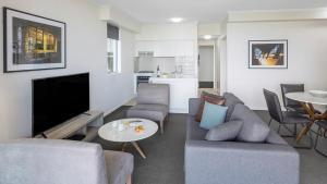 A seating area at Oaks Brisbane on Margaret Suites