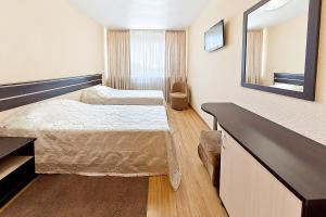 Кровать или кровати в номере Гостиница Кавказ
