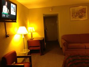 A seating area at Americas Best Value Inn Macomb