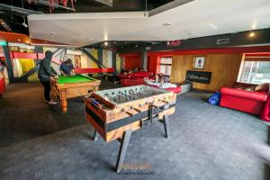 A pool table at Nomads Queenstown Backpackers