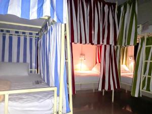 A bed or beds in a room at Rainbow Lining Hostels