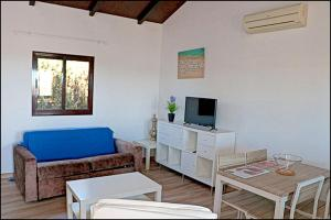 A seating area at Bungalow Ramos II