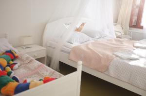 Säng eller sängar i ett rum på Hotel Villa Vanessa