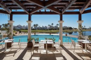The swimming pool at or near Doubletree By Hilton La Torre Golf & Spa Resort