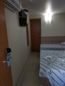 Cama ou camas em um quarto em Hotel Stela