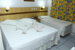 A bed or beds in a room at Mar Hotel