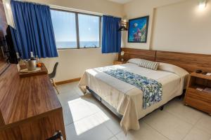 A bed or beds in a room at Rede Andrade Riviera Premium