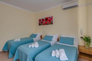 Letto o letti in una camera di Hotel Massimo