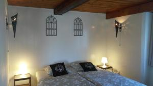 A bed or beds in a room at Bed and Breakfast Tvrz