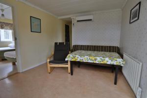 Säng eller sängar i ett rum på Bro Ekes Gård