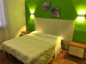 Letto o letti in una camera di La Mimosa B&B