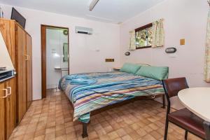 A bed or beds in a room at Big4 Naracoorte Holiday Park