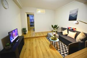 A television and/or entertainment center at Split level with courtyard next to Darling Harbour