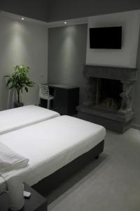 A bed or beds in a room at OM Palace