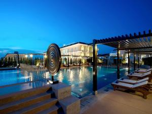 The swimming pool at or near Millennium Resort Patong Phuket