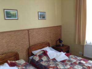 A bed or beds in a room at Kastani Home Accommodation