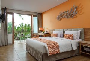 Ein Bett oder Betten in einem Zimmer der Unterkunft Mahagiri Resort Nusa Lembongan
