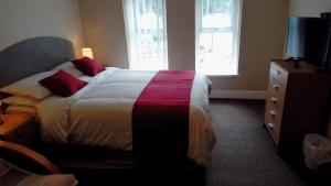 A bed or beds in a room at Mount Pleasant