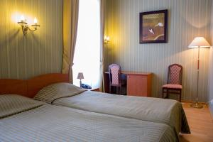 A bed or beds in a room at Ekaterina