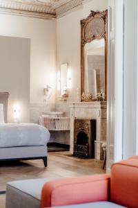 Кровать или кровати в номере Maison Hustinx op het Vrijthof