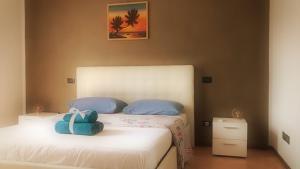 Letto o letti in una camera di KARINA'S home