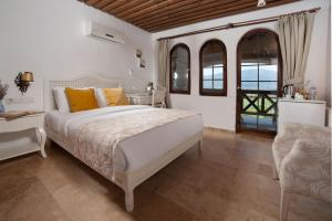 A bed or beds in a room at VINIFERA VINEYARDS HOTEL