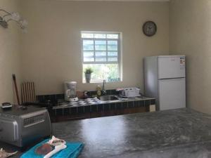 A cozinha ou cozinha compacta de Flamingo Studio Sunset Heights