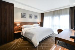 A bed or beds in a room at Sheraton Novi Sad