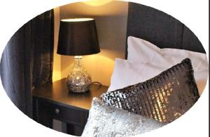 A bed or beds in a room at The Rooms at The Spout