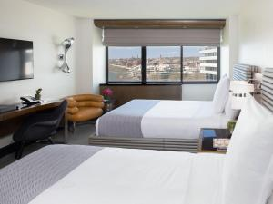 A bed or beds in a room at The Watergate Hotel Georgetown