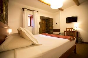 Cama o camas de una habitación en Tierra Viva Cusco Centro