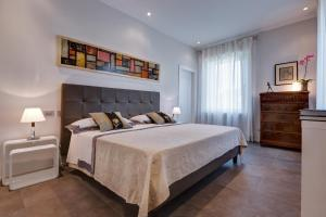 A bed or beds in a room at Appia Antica Resort