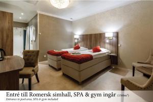 Ein Bett oder Betten in einem Zimmer der Unterkunft Himmelsby SPA & Konferens