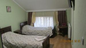 A bed or beds in a room at Diamond De Luxe