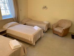 Кровать или кровати в номере Макс Хаус