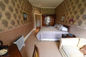 A bed or beds in a room at Castle Hotel