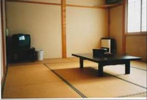 A television and/or entertainment center at Oyado Sumire-so
