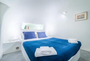 A bed or beds in a room at Fava Eco Suites