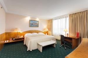 Кровать или кровати в номере AZIMUT Отель Олимпик Москва