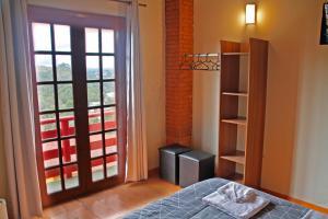 Cama ou camas em um quarto em Pousada AlpenRose